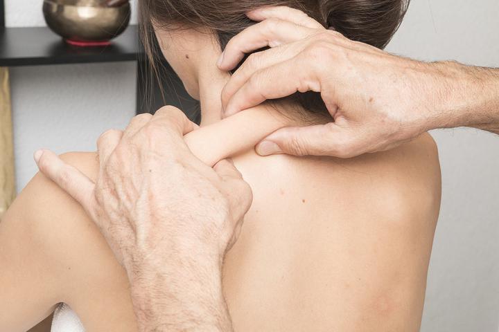 массаж при болях в спине